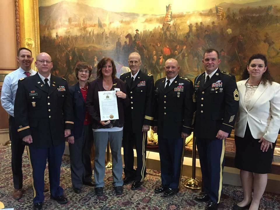 "Veteran Suicide Awareness event at the statehouse in April, 2018. A resolution, sponsored by Vicki, to honor Valerie Pallotta (pictured with resolution), and her efforts to bring awareness to Veteran Suicide issues after her veteran son Josh succumbed to suicide. The resolution, co-sponsored by other legislators, such as Laura Sibilia (far right, white jacket) can be read  HERE.   To learn more about Valerie Pallotta's organization ""Josh's House"" and find ways to help out, click  HERE."