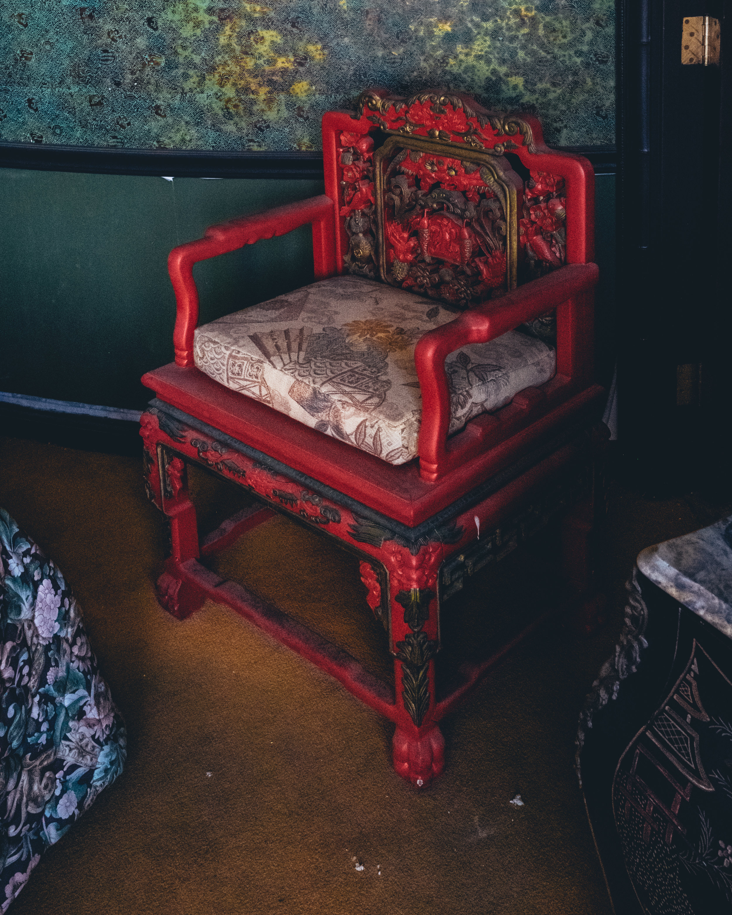 This chair's pop of red in an otherwise cool toned room is something I'm going to do in my next apartment.