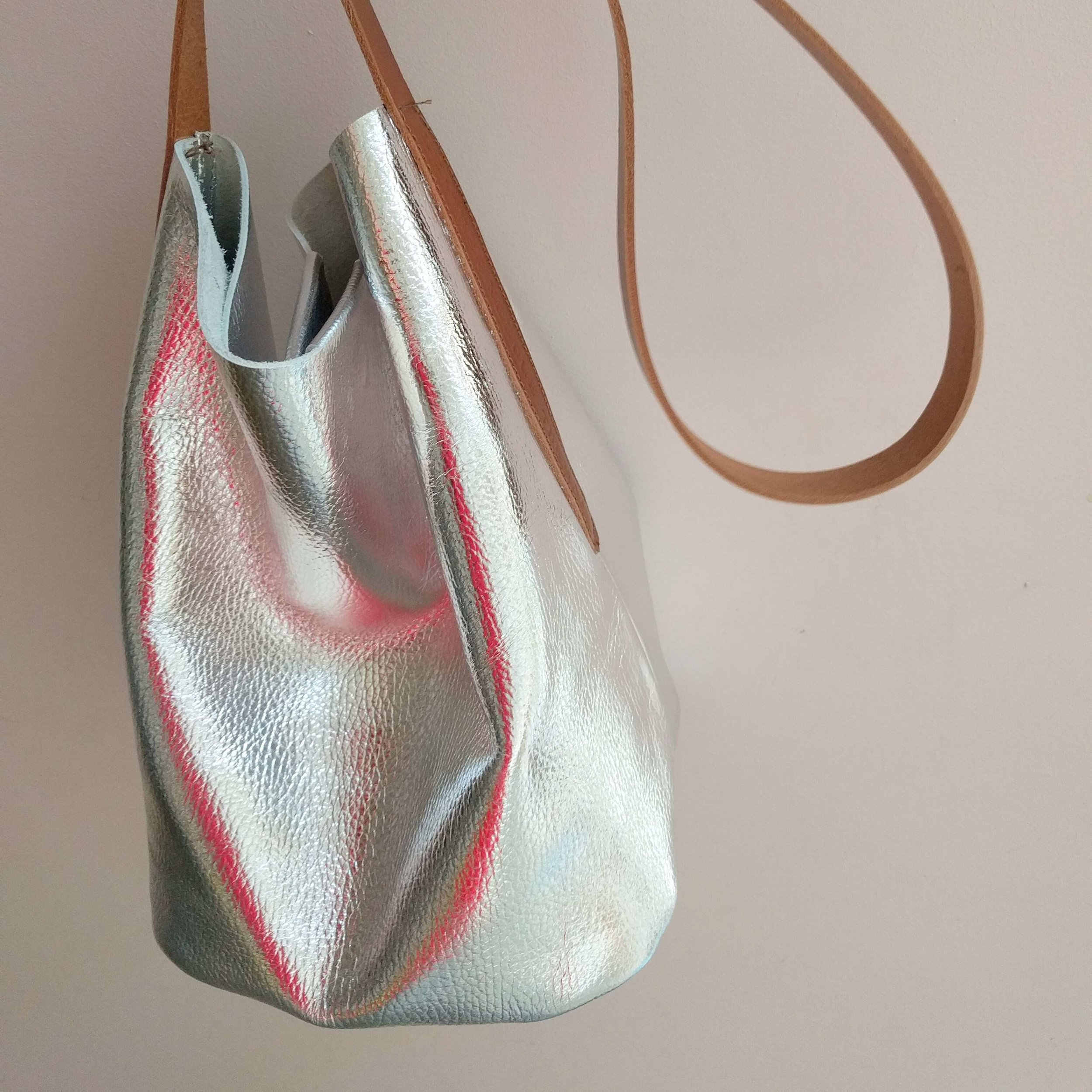 silver-leather-bucket-bag-tan-strap.jpg