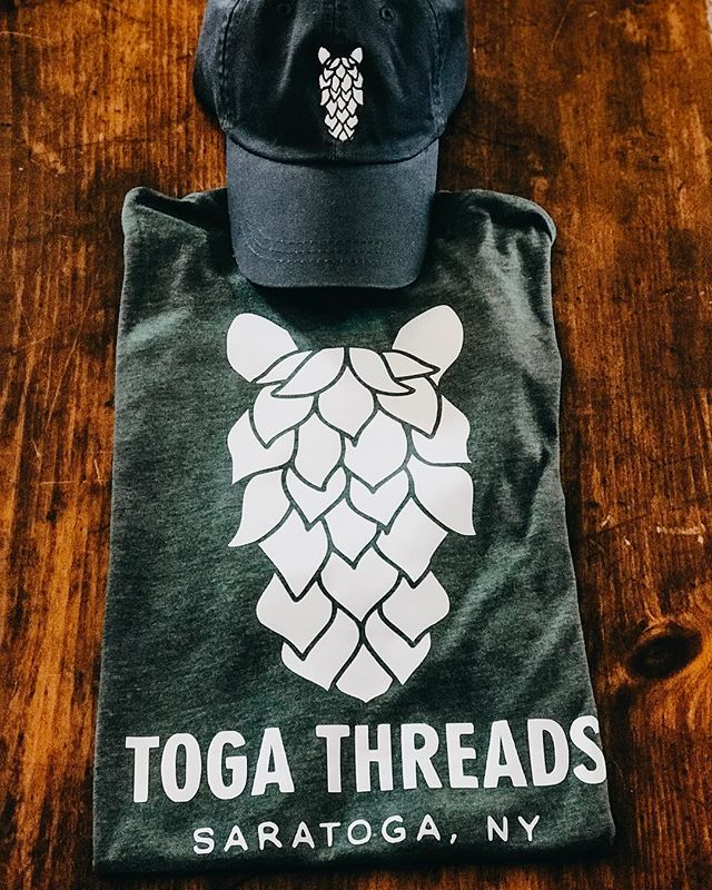 """Due to the horrific loss that @commonrootsbrewing suffered this week, Toga Threads would like to donate $1 from every """"Hop"""" t-shirt and hat to the rebuild of the new brewery. //Cheers\\ ➖➖➖➖➖➖➖➖➖➖➖➖➖➖➖ #supportsmallbusiness #brews #southglensfalls #hops #craftbeer #whattowearattheplacetobe"""