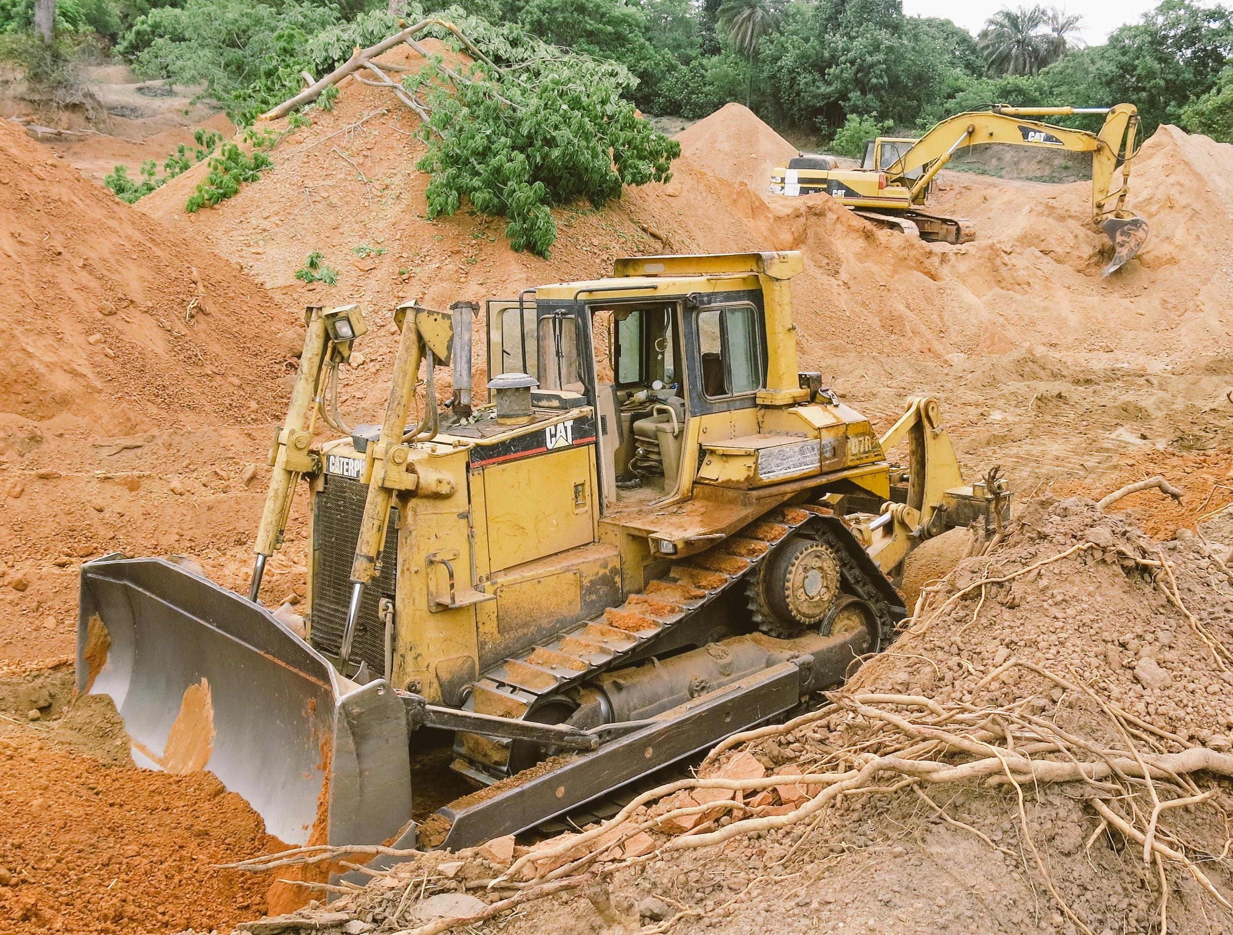 Bulldozer preparing road materials