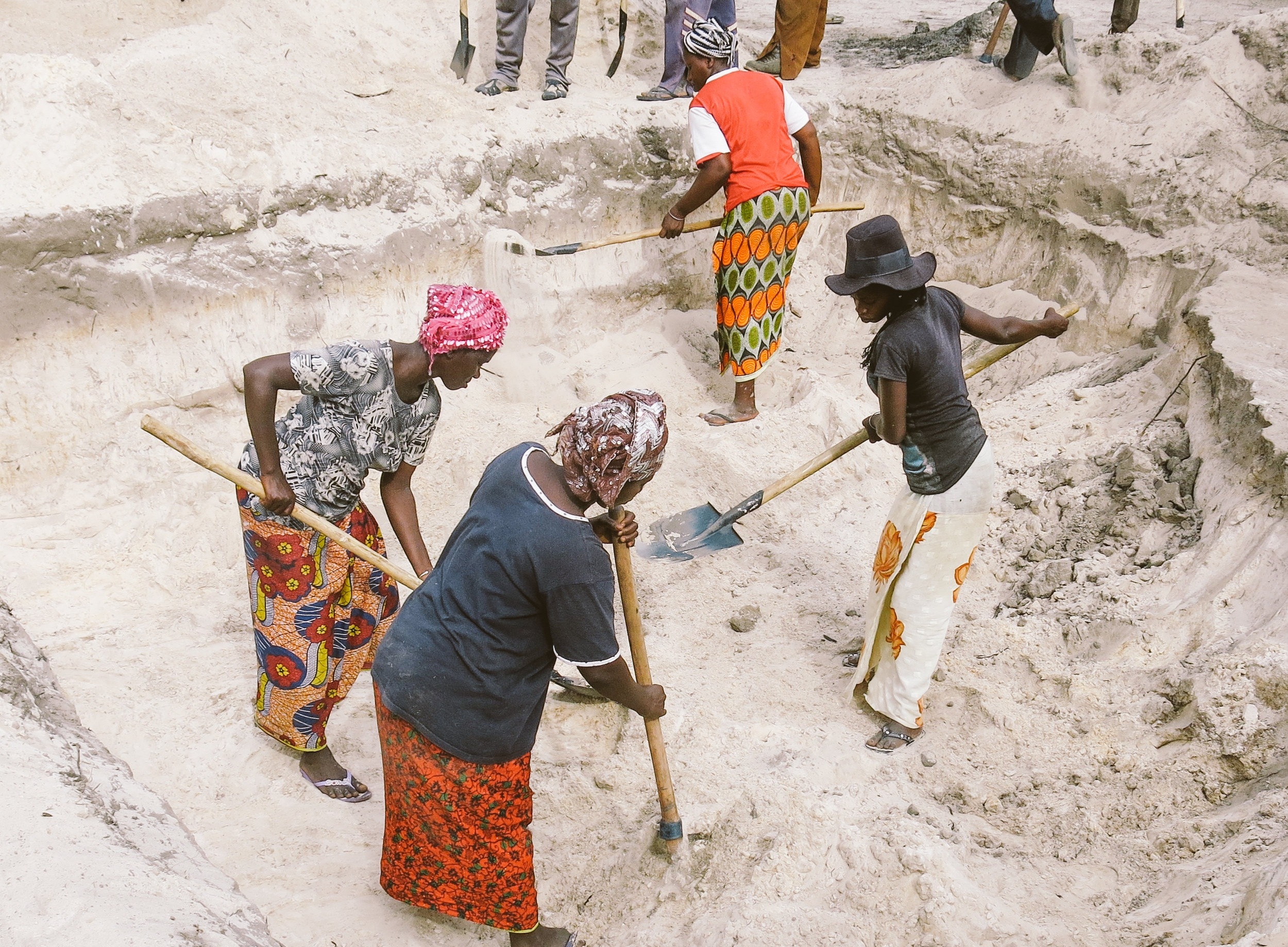 Workers mining laterite soil for the new roads