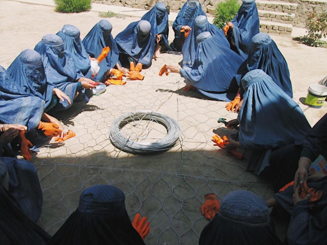 Women attending a Gabion Weaving Training course through our vocational training program