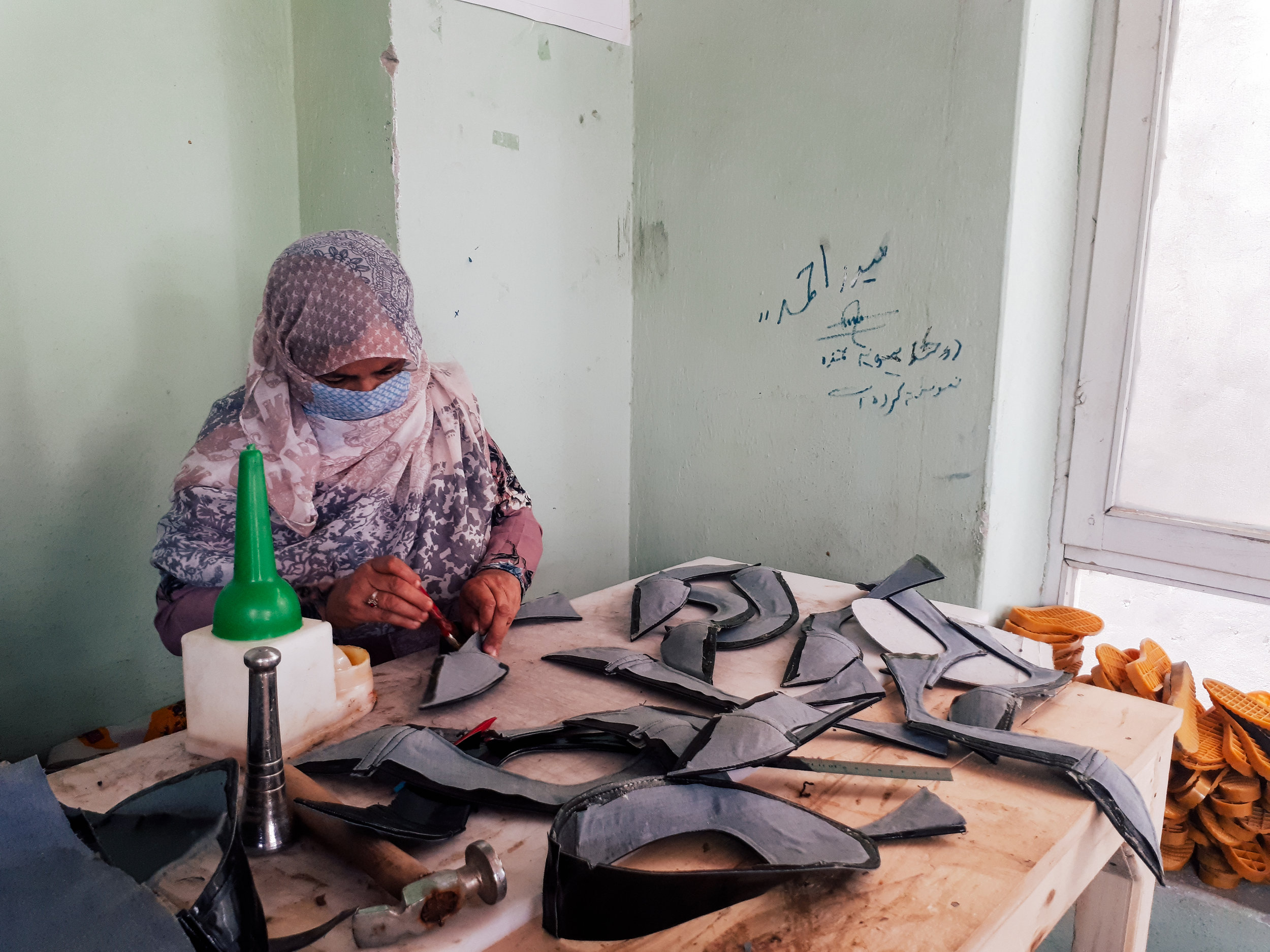 One of our shoe making trainees in class