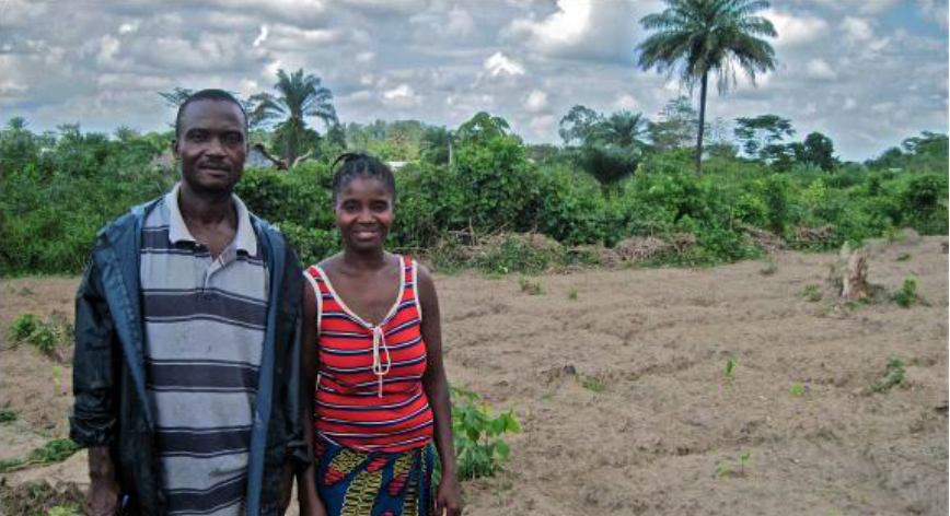Morie and a farming association member at one of their farming lots