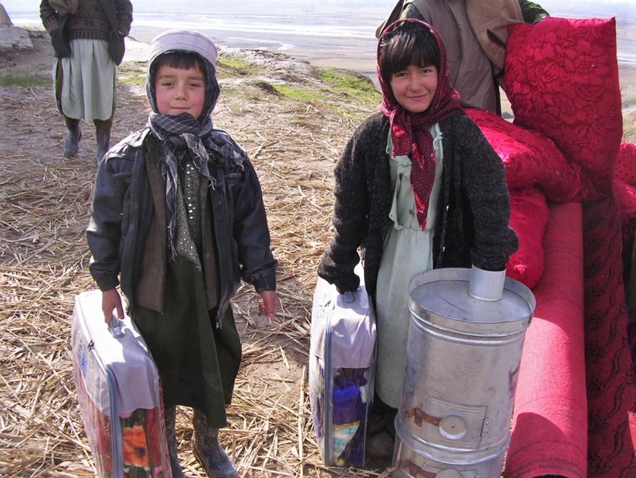 Children from Tahkar province receive stove and other winterization goods