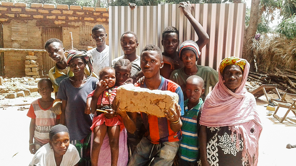 Family with the building materials for their new home