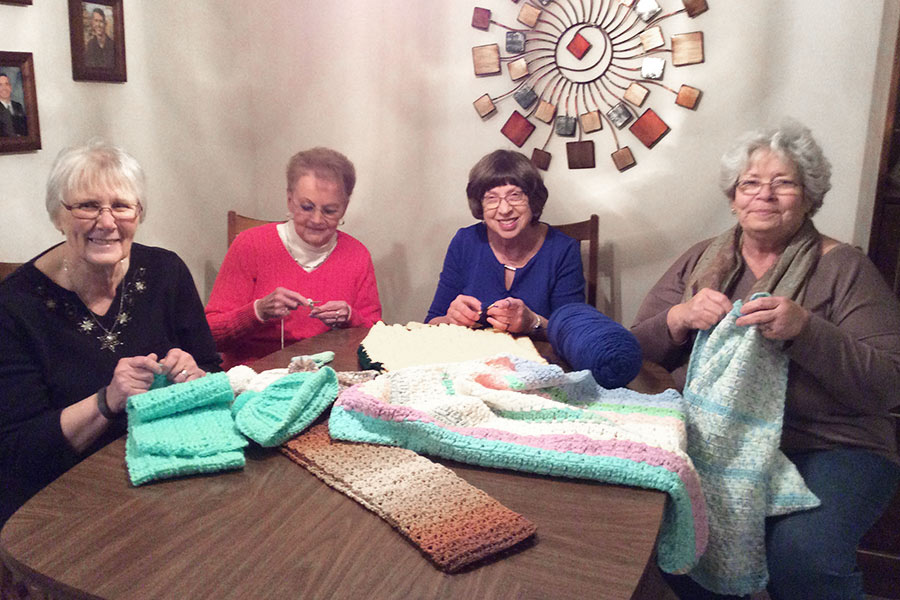 Knitting blankets and booties for the newborns!