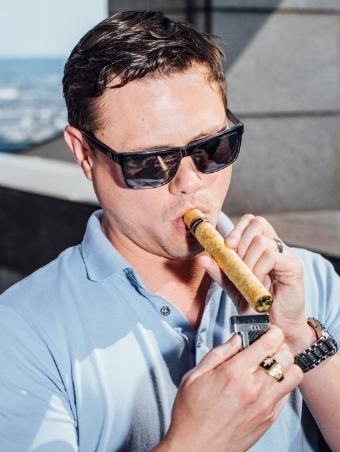 Justin Costello smokes his newly purchased $10,000 cannagar on Monday, June 18, 2018 in Seattle. (Grant Hindsley for Leafly)