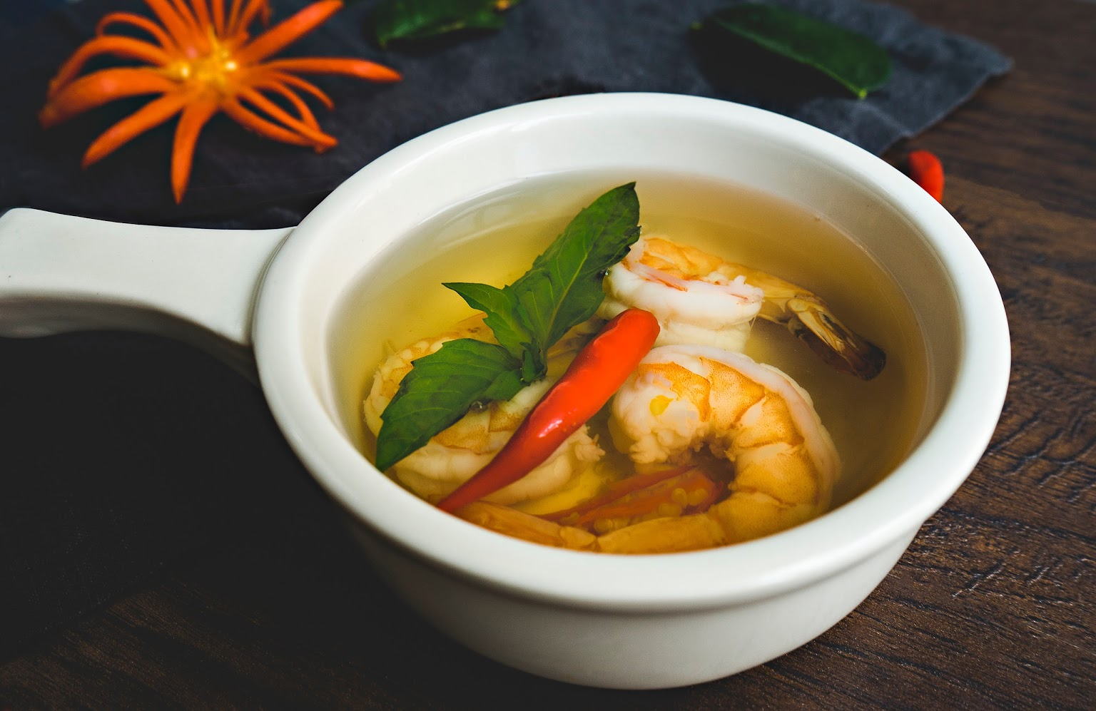 Lemongrass Soup served with the aroma of basil leaves and mixed herbs