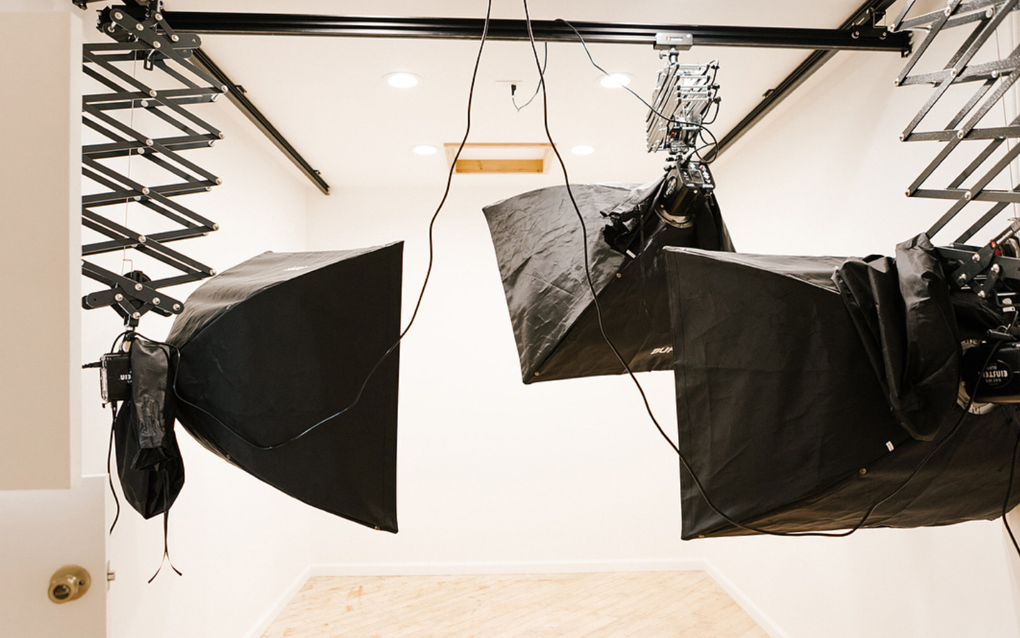 Flash Light Studio: Enclosed white space complete with lighting and photographic equipment. Get creative with birds-eye photography from the ceiling entrance. The perfect quarters for model shots, product lay downs, or anything else you might dream up.