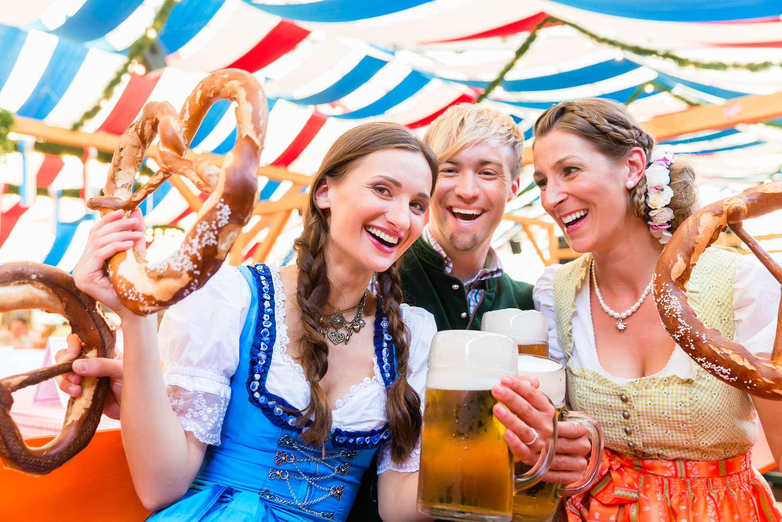 bigstock-Three-friends-in-beer-tent-at--143615687.jpg
