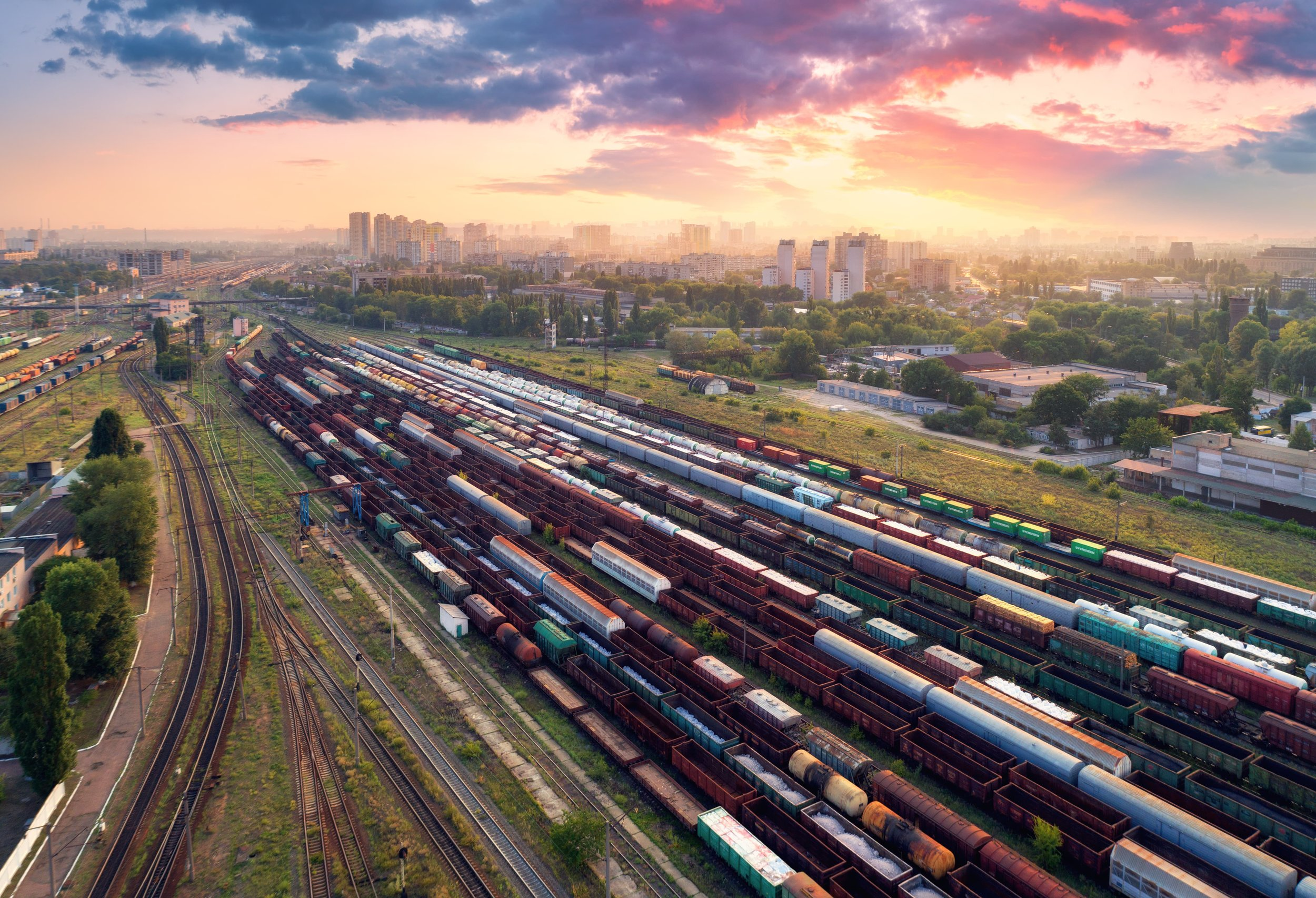 aerial-view-of-colorful-freight-trains-railway-PX77SW3-min.jpg