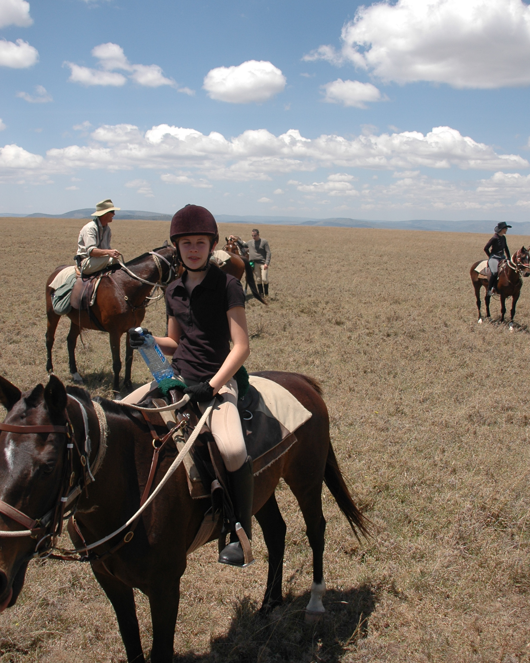Catherine, aged 14, riding with the great migration across the Masai Mara, in Kenya.