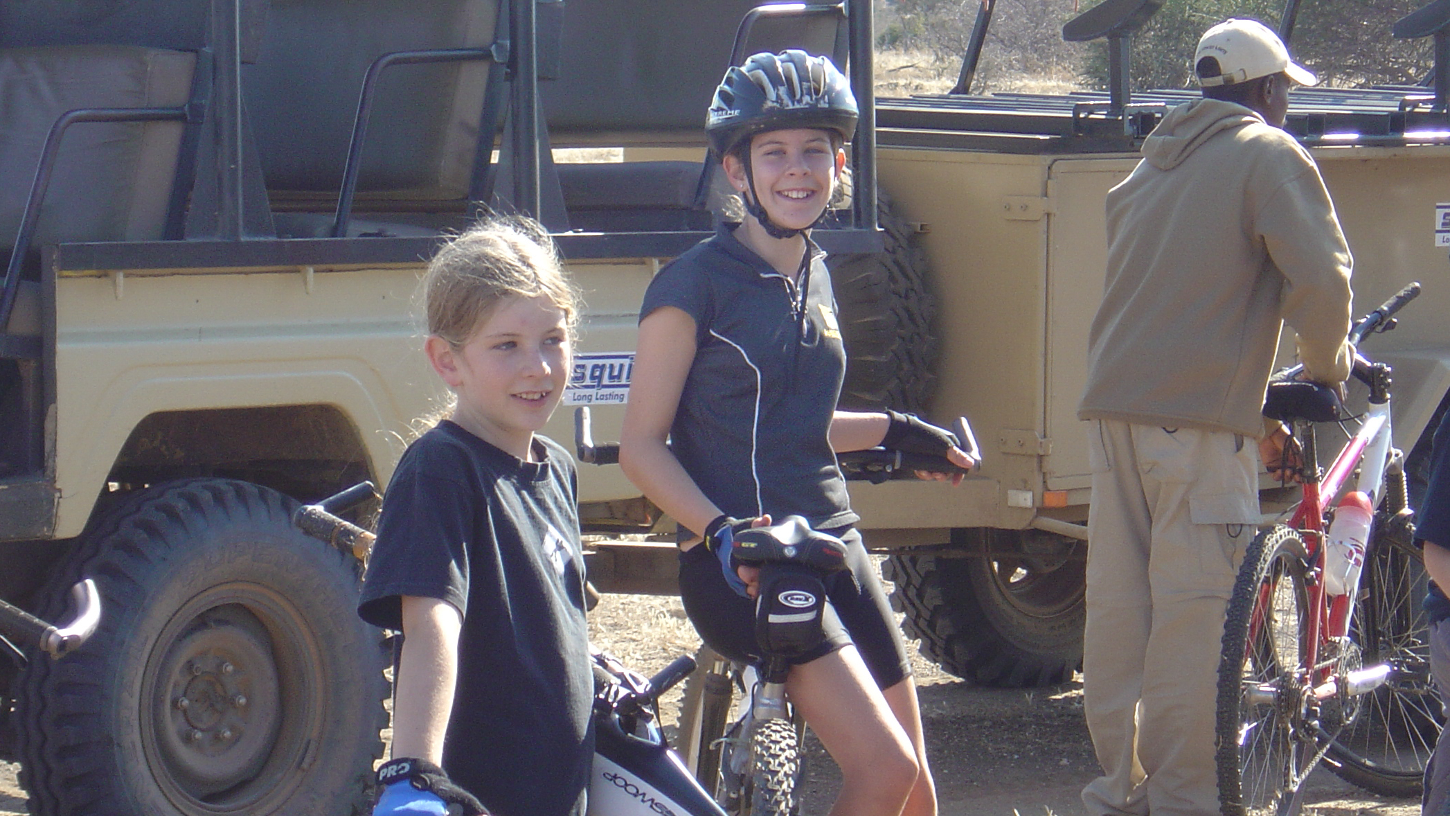 Catherine and Alice, ages 13 and 10, riding bicycles through Botswana.