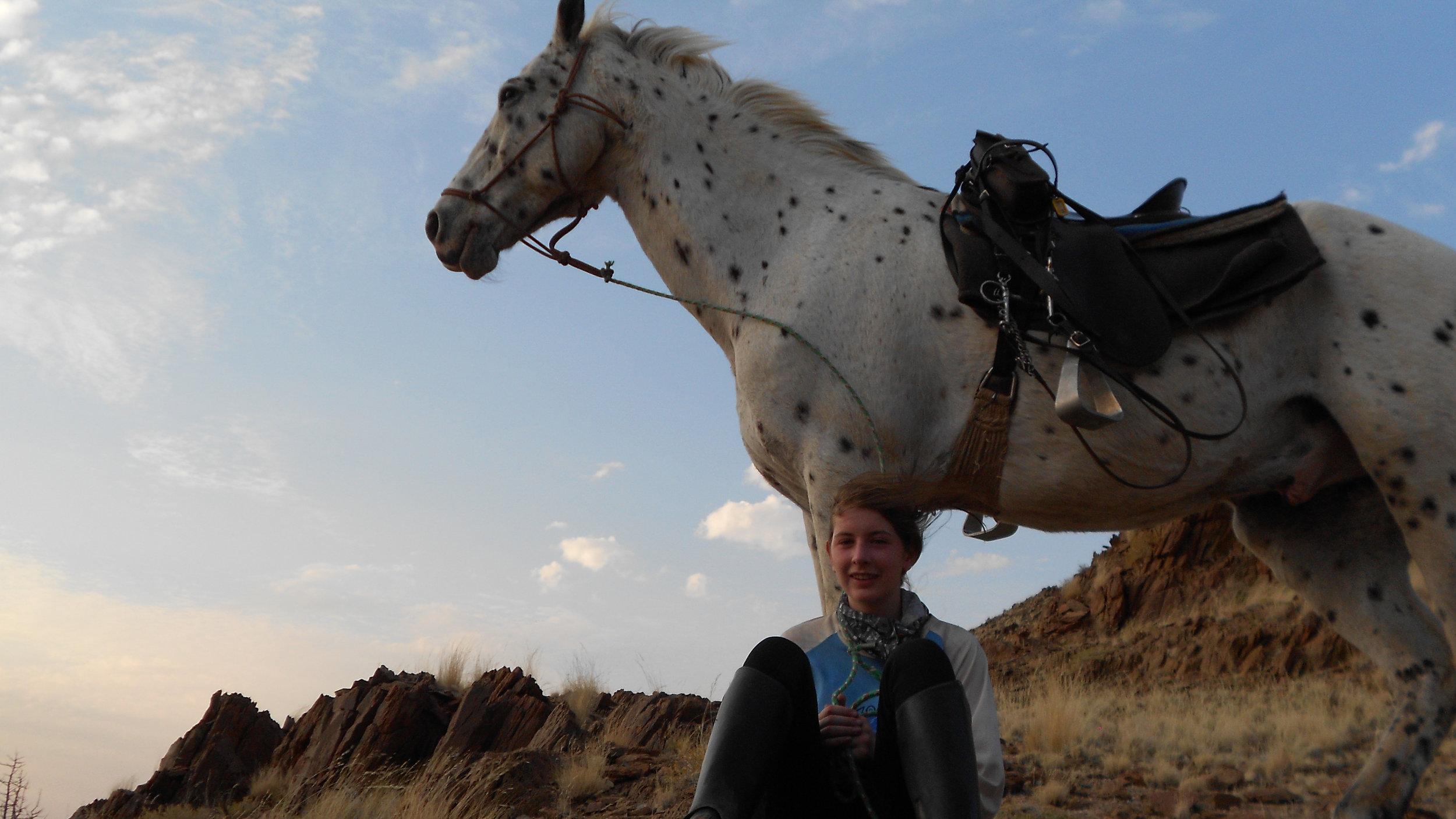 Alice, age 16, riding across Namibia.
