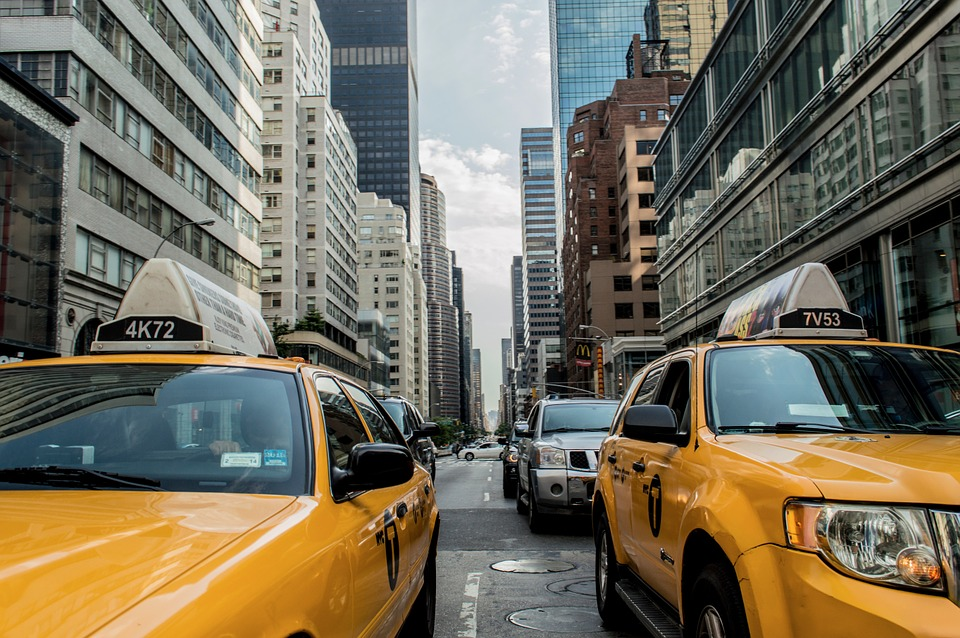 A busy city street with yellow taxi cars