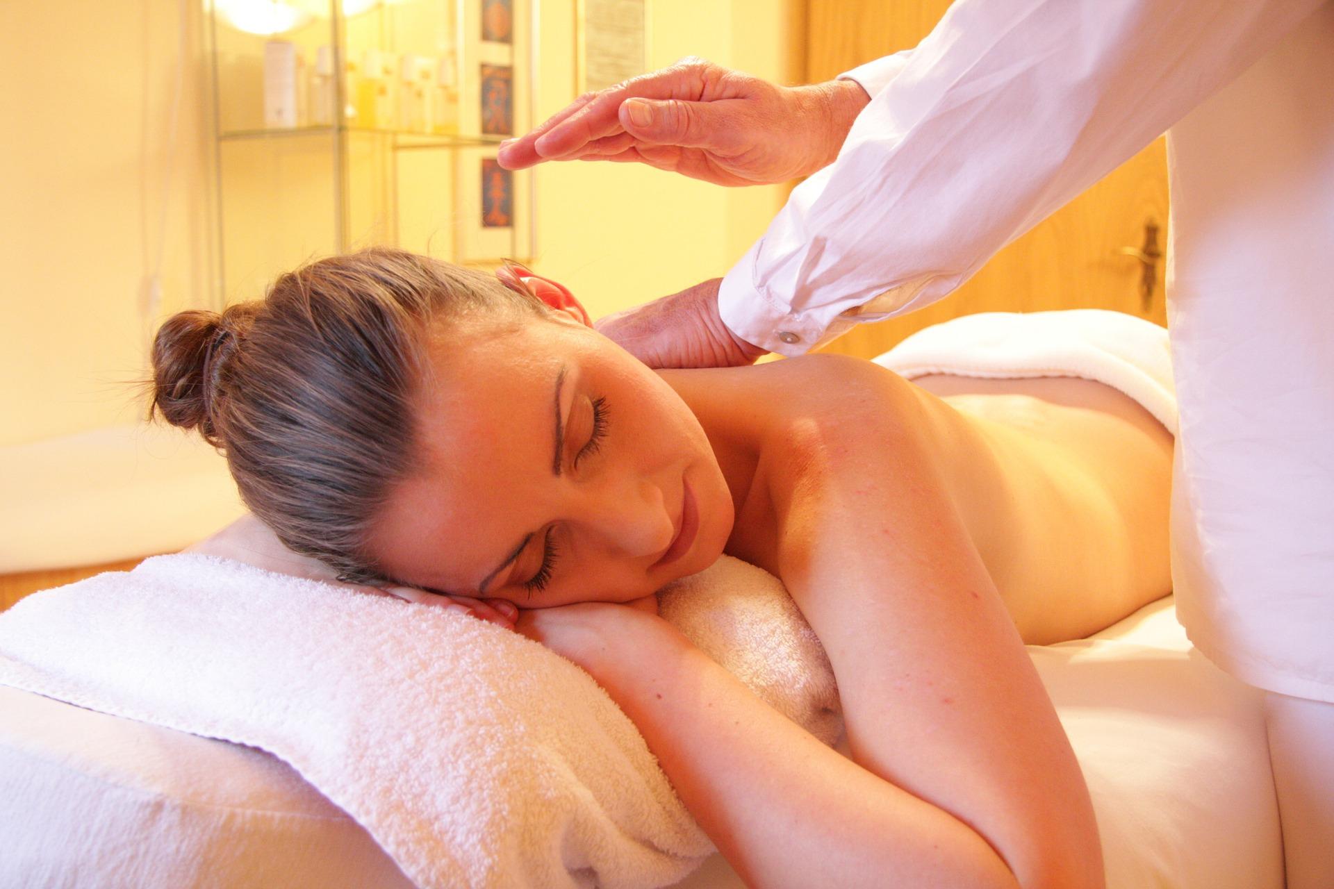 A woman being massaged