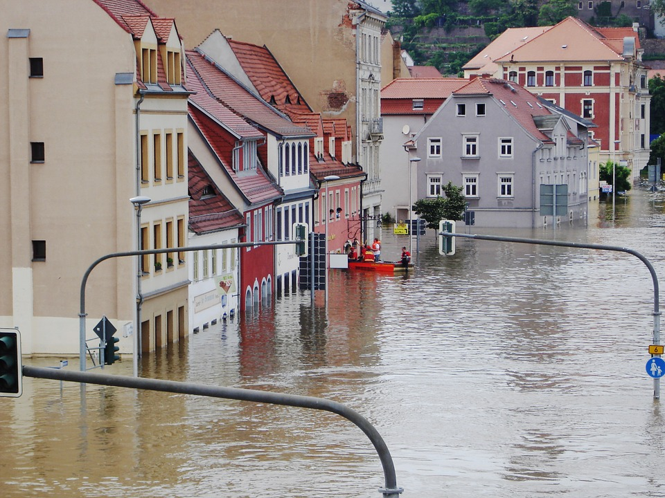 A flooded street lined with buildings