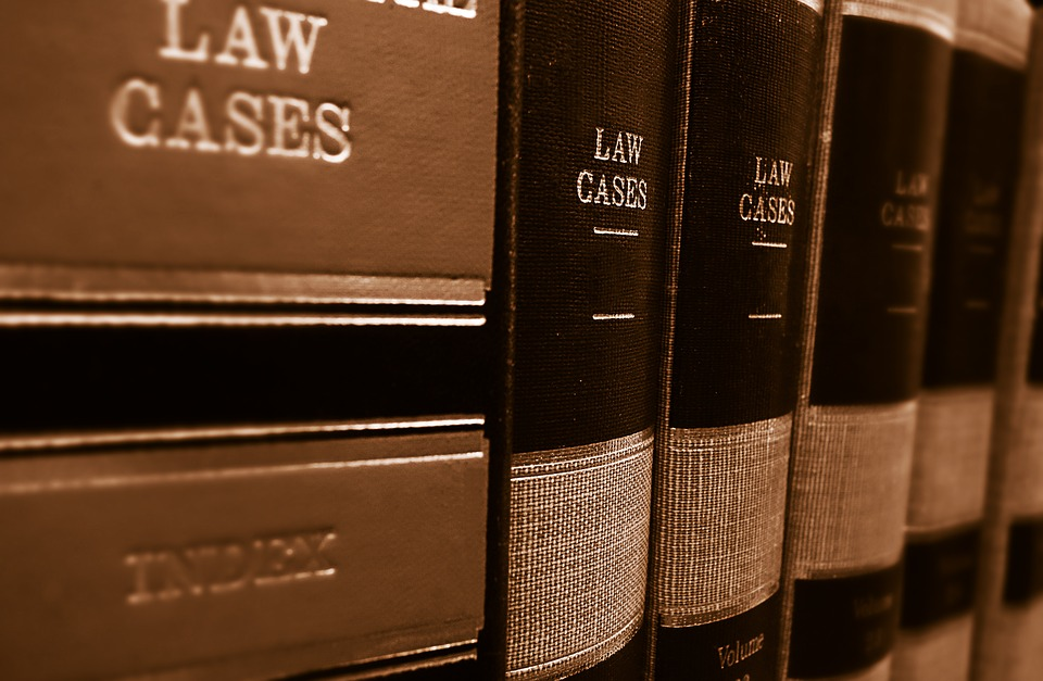 Law books lined up on a shelf