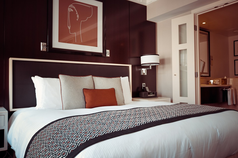 A hotel bedroom with a nice plush bed