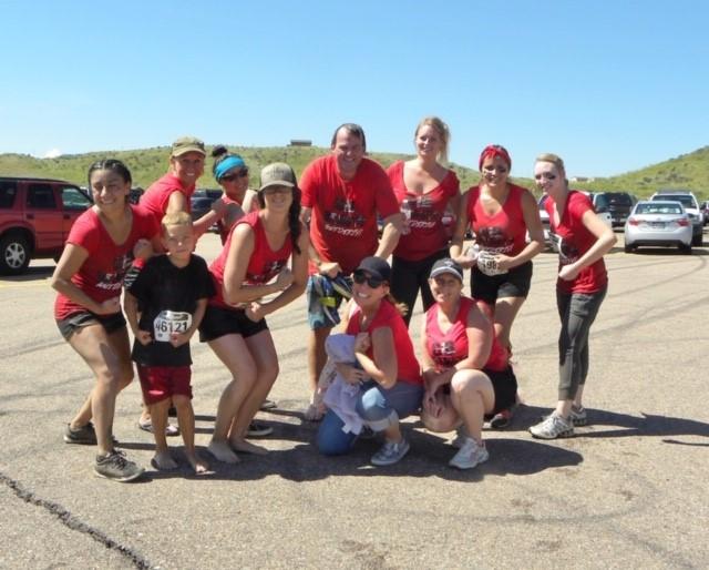 Bigfoot Insurance team members in red participating in a local Mud Run
