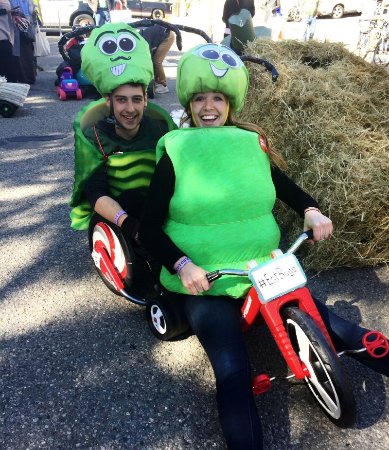 Laura dressed as a bug on a tricycle