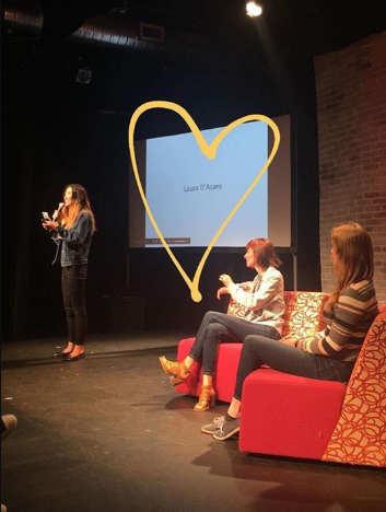 Rose presents Laura at Tinder Disrupt. Please excuse the drawn on heart, this is a screenshot.
