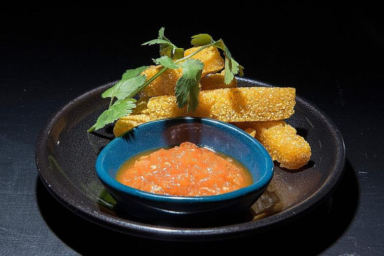 Mopani Polenta Fries (above). Basil Pesto Taglietelle, made with ground black soldier fly larvae. PHOTO: AFP