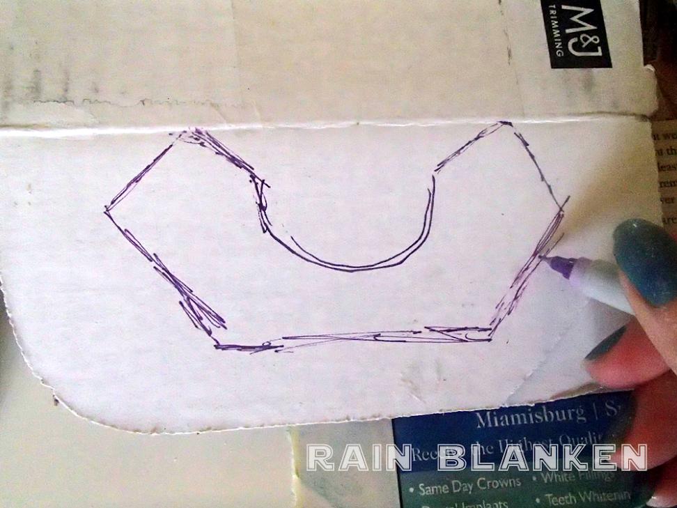 I traced my rough idea of the shape onto cardboard.