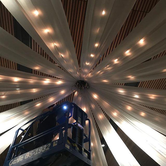 Setting up ceiling drapes, fairylights and chandelier @joondalupresortweddings #specialoccasionswa #ceilingdrapes #ceilingsilks #perthweddings #perthbrides #weddingstyling #weddings