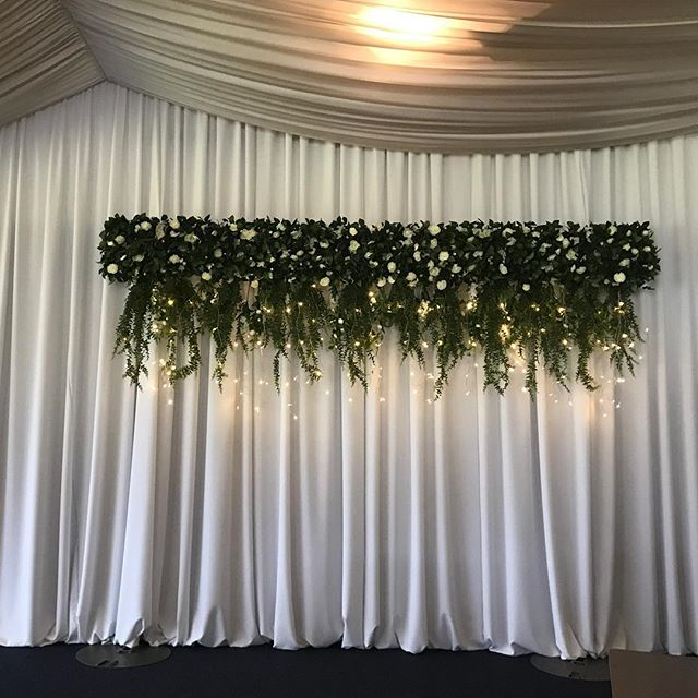 Our Hanging Greenery backdrop ready and waiting for a bridal table @burswood_on_swan  #specialoccasionswa #weddingdecor #weddinginspo #weddingstyling #perthbrides #eventstyling #weddingbackdrop #hanginggreenery #backdrop