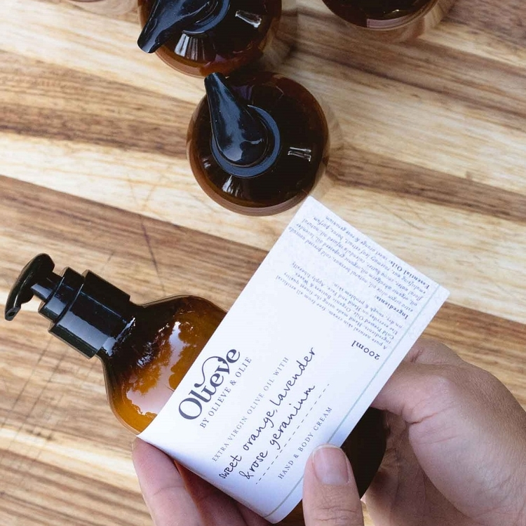 olieve-and-olie-putting-labels-on-by-hand.jpg
