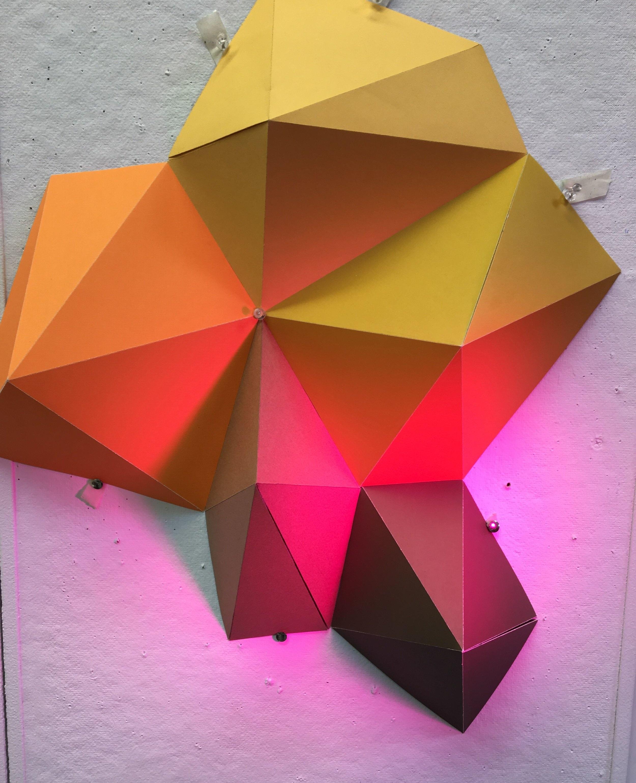 Paper Pentagons under Violet Light