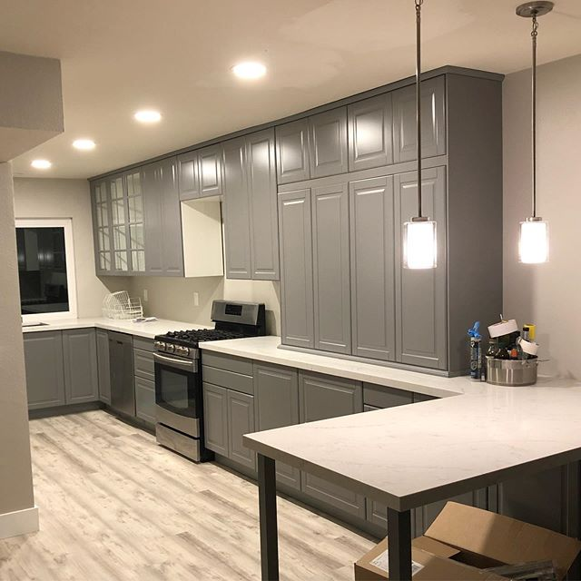 Still a work in progress and filled with boxes and things now but here is the beginning of my masterpiece! #newkitchen #ikeakitchen #ikeacabinets #grey #agreeablegray #lifeproofflooring #quartzcountertops #pendantlights #kitchendesign #kitchen #kitchenremodel #kitchenrenovation #makeover #sandiegoremodel #houseflipping