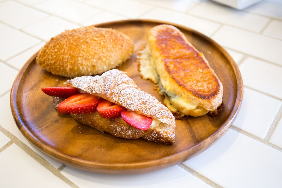 Pictured clockwise: Okayama Kobo's Japanini, Strawberry Milk Cream Croissant, Curry Pan