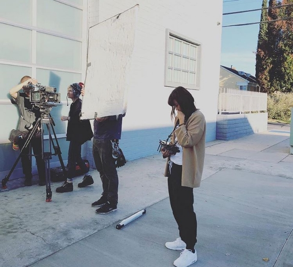 Tess on set and directing The Patients.
