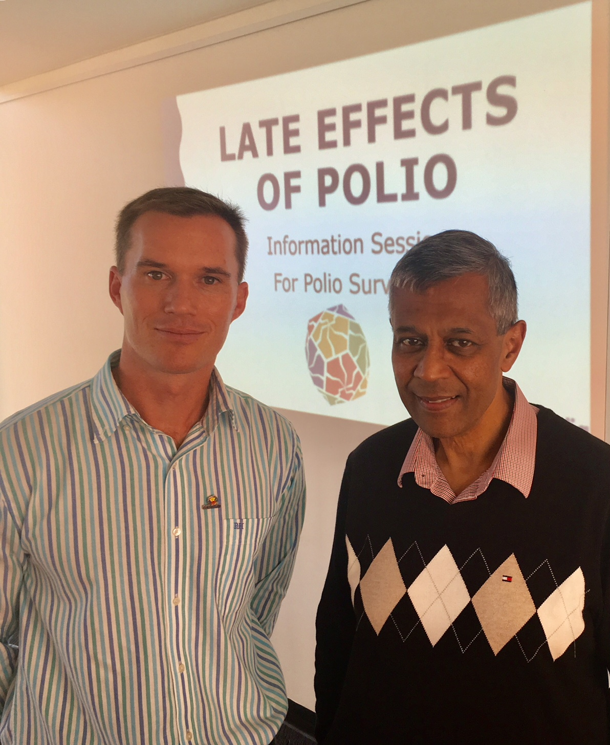 Image of Paul Cavendish & Dr Quadros at a Polio survivor information session
