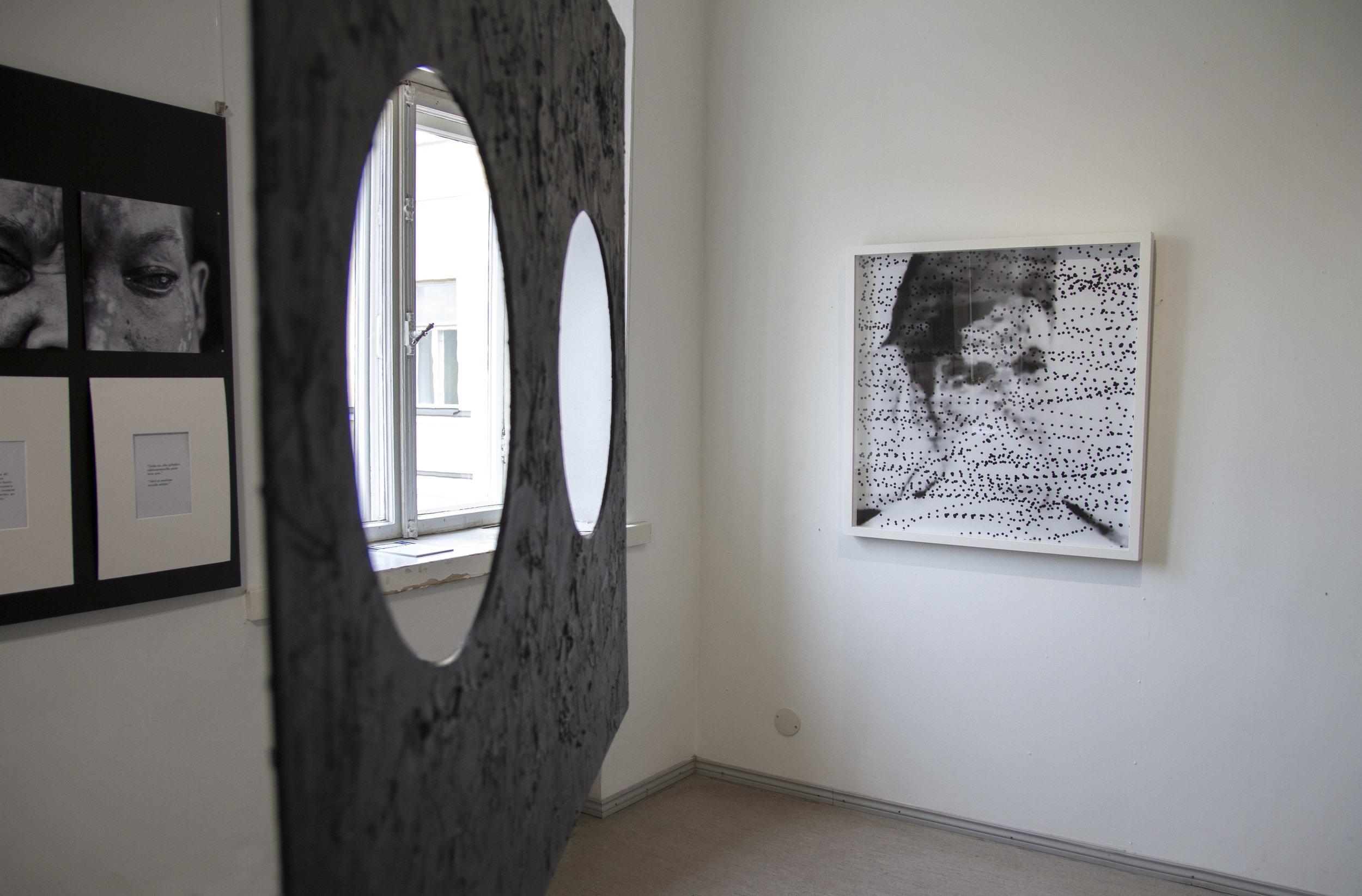 Installation view, from left: Iiri Poteri:  Pimeän jälkeen  (2014) and back: Eeva Hannula:  Dead Spots  from the series  Epävarmuuden Rakenne  (2012)
