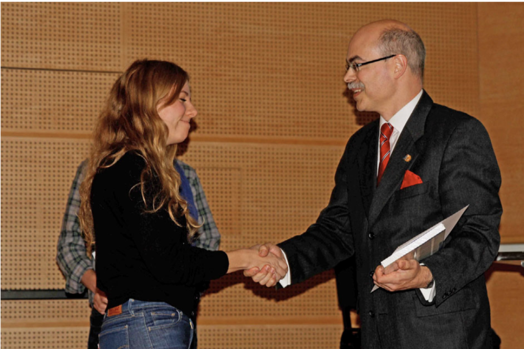 Haymo Ross presenting Laurie Peverini with her award for an out- standing poster performance