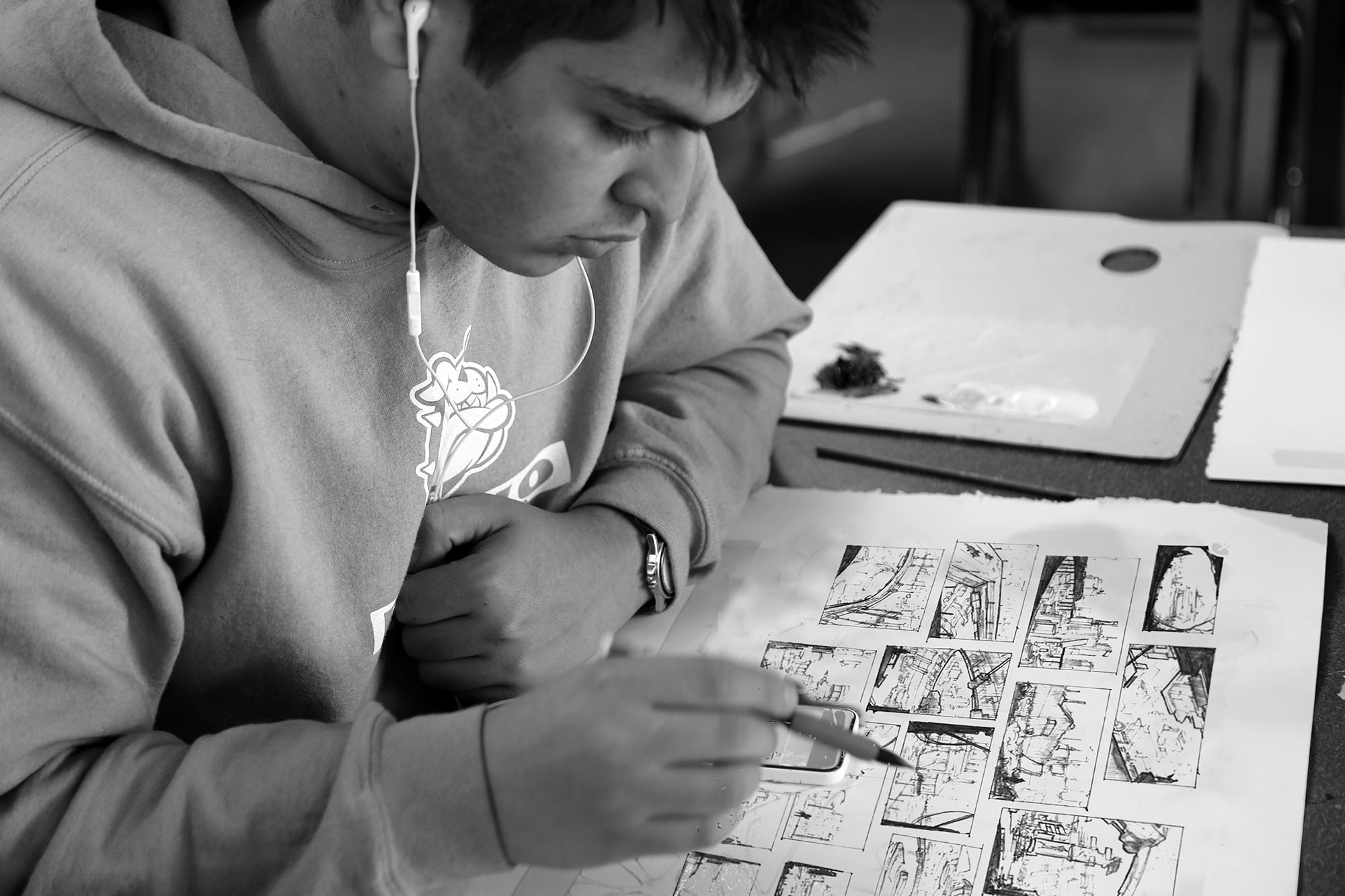Student puts together a storyboard, Provo High School