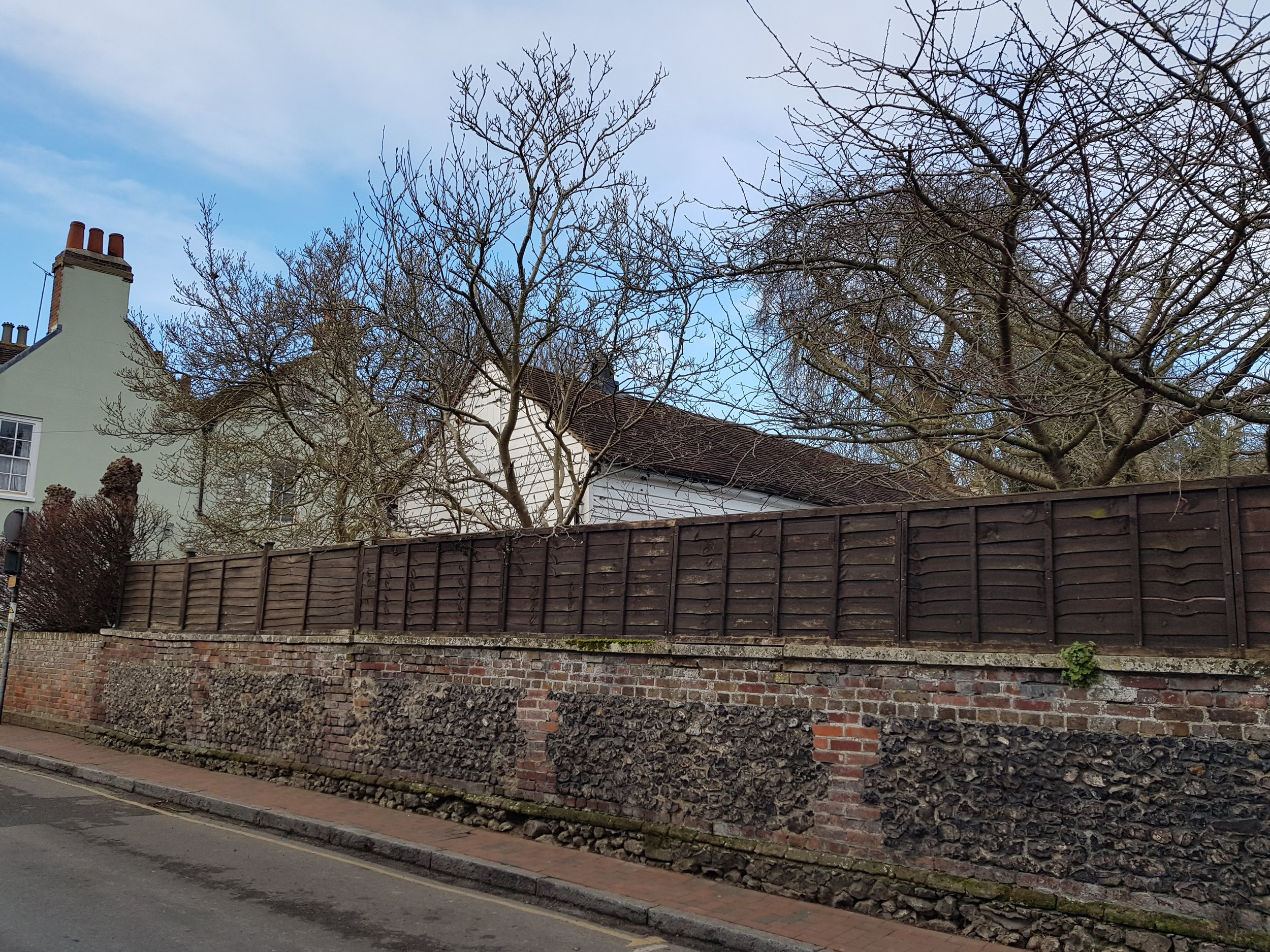 Gable ends form a rhythm along the road frontage. -