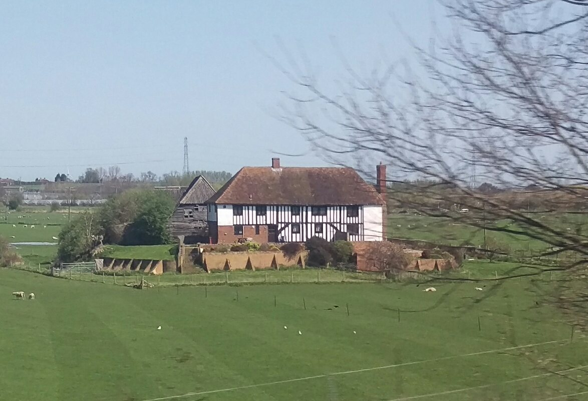 Kent farmhouse on a raised on a mound between Sittingbourne and Faversham -