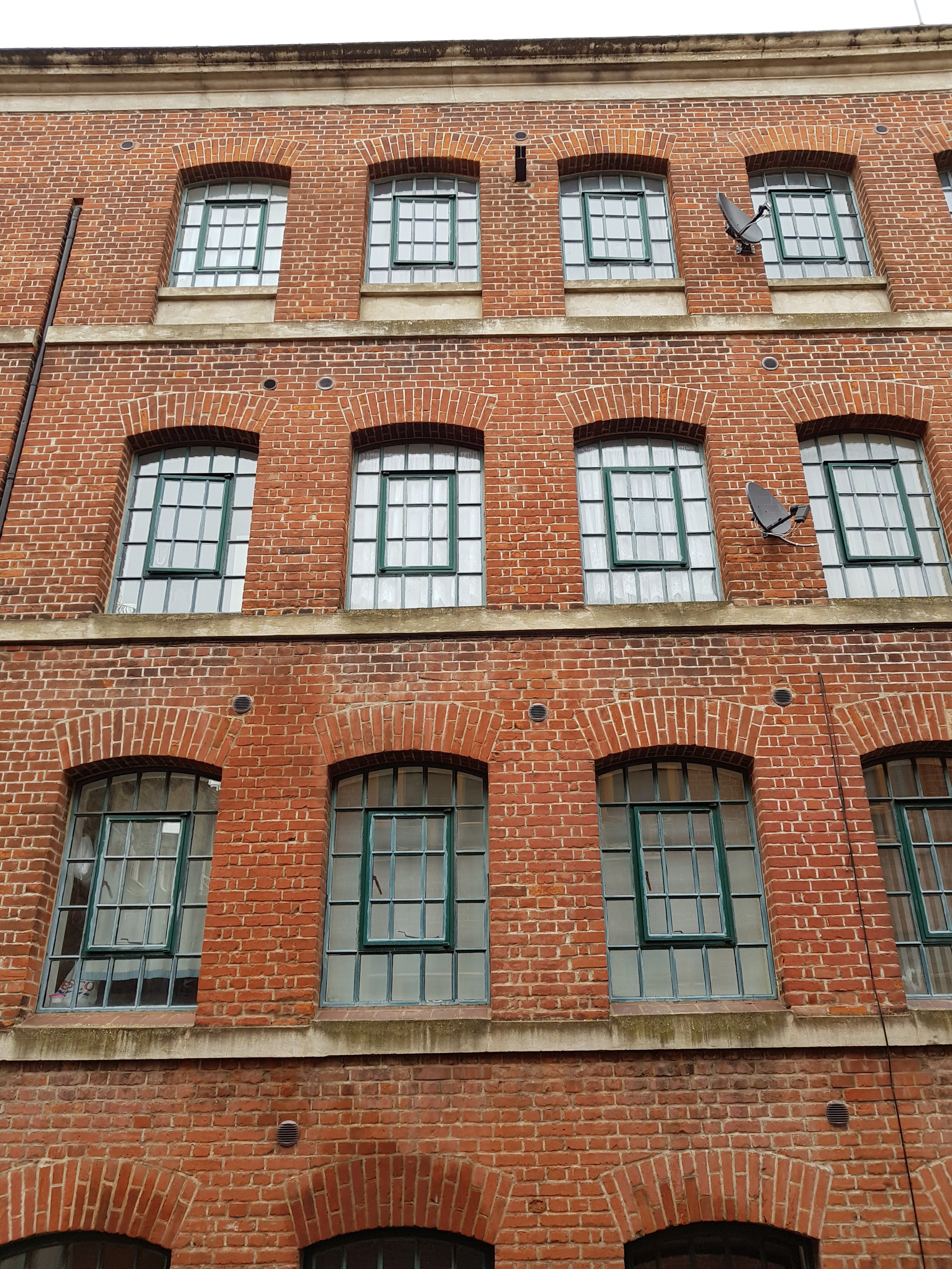 Warehouse - storeys high-lighted with continuous stone articulation -