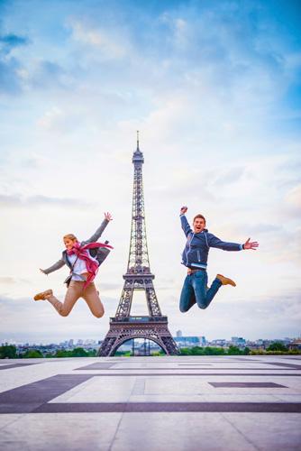 France_Paris_Eiffel-Tower-people-jumping_GettyImages-543195031.jpg