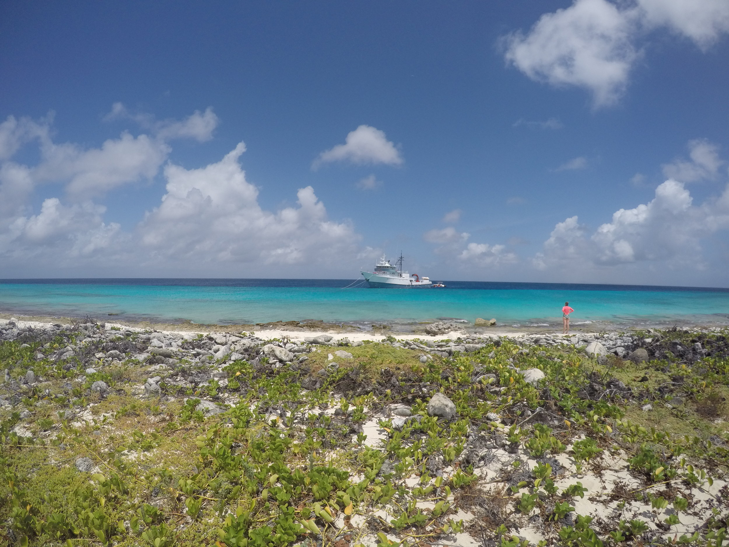 Explorer on the shore of uninhabited Klein Curaçao with RV Chapman in the distance.JPG
