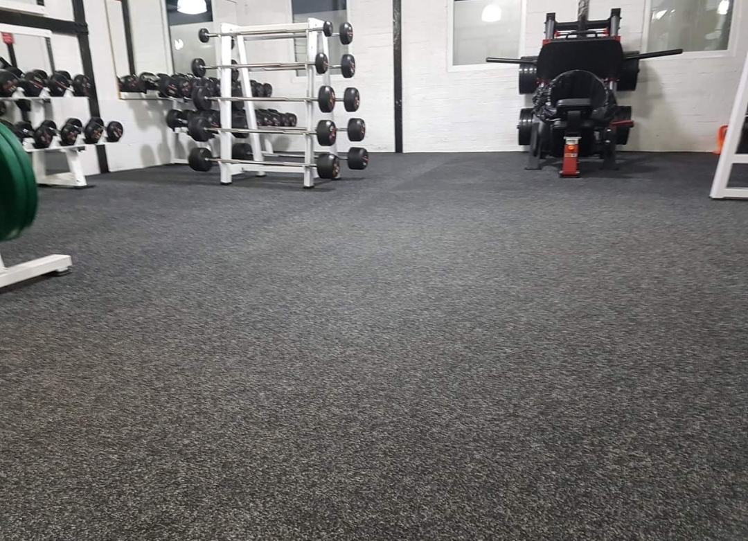 Clean floors on a commercial gym