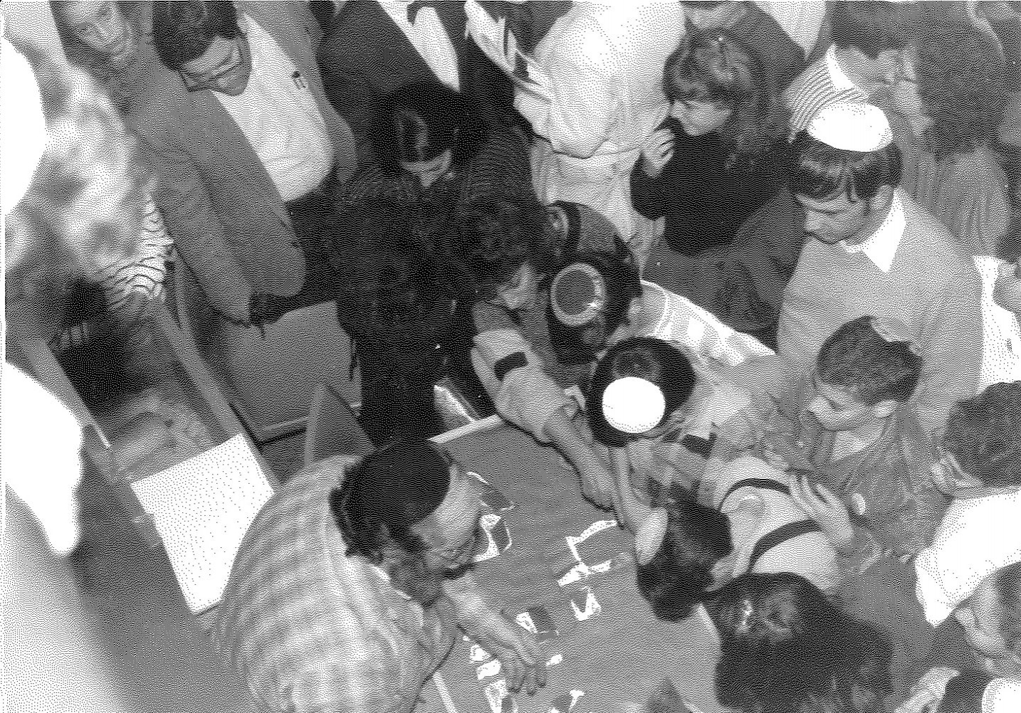 Rabbi Nulman (center) surrounded by students placing shards of stained glass into the mosaic. The Am Yisrael Chai mosaic still hangs in the SAR Academy building, 30 years later.