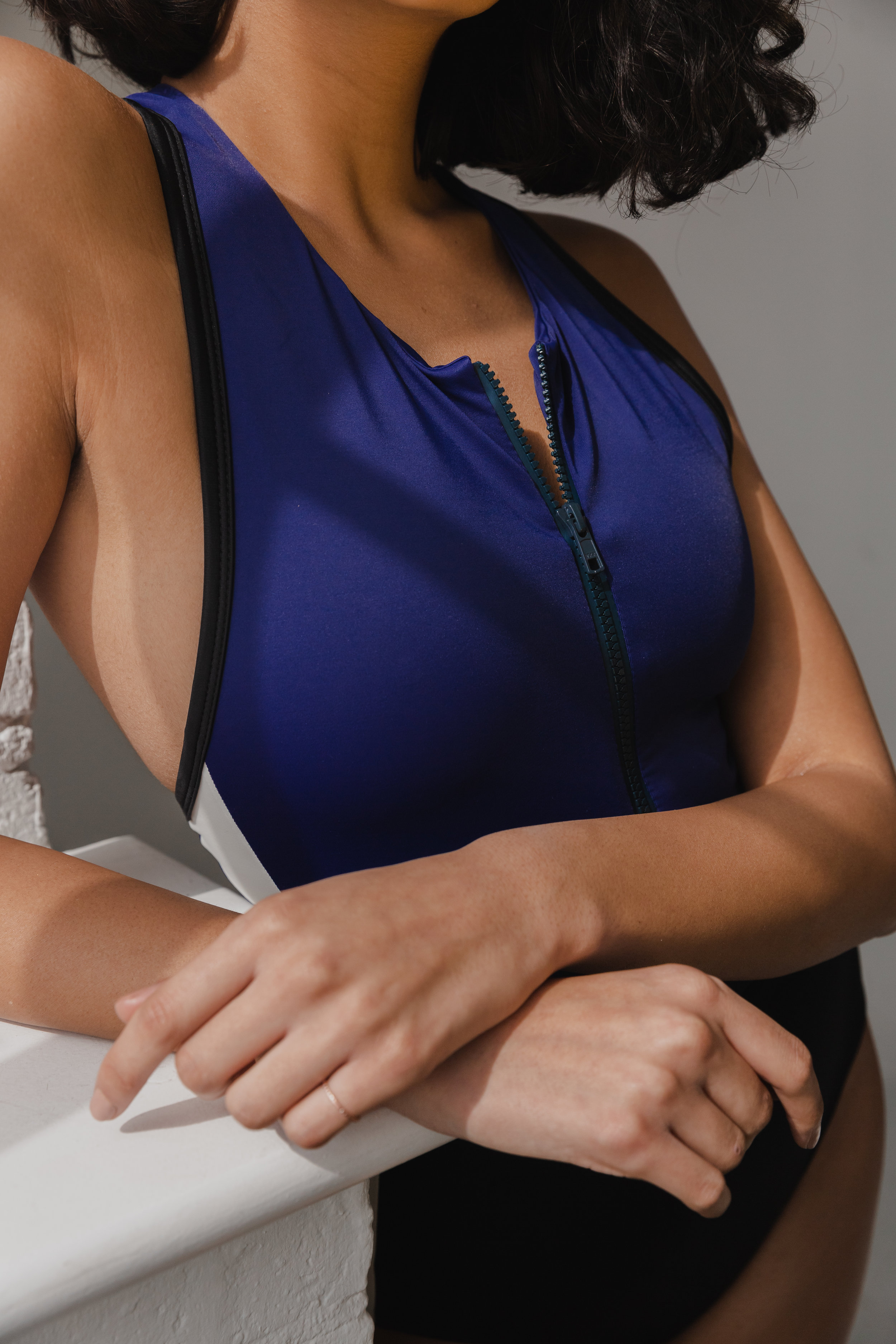 ODYSSEY ONEPIECE - Designed by Zanna and Natalie to be flattering, feminine and functional. Coloured panels provide sculpting and the raised sporty neckline gives a higher level of support, perfect for more active pursuits. Double lining provides the highest quality and the premium zip allows the piece to be worn with ease.