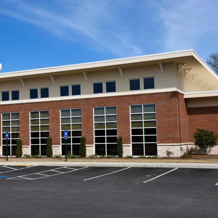 bigstock-New-Commercial-Building-86067554-1024x759 (1).jpg